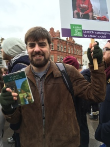 Book in one hand, placard in the other!